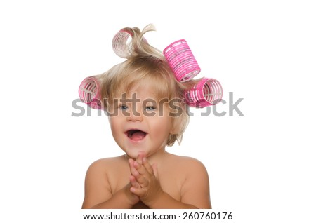 little laughing girl with hair curlers isolated on white - stock photo