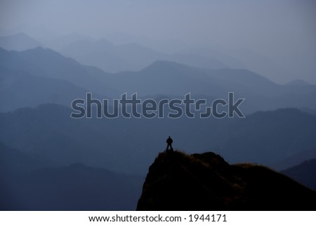 Little Man Against Blue Mountains Background - stock photo