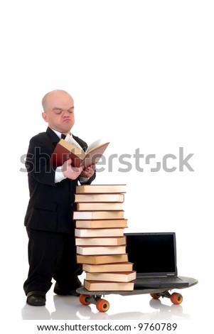 Little man, dwarf businessman speed surfing on internet library, metaphor with skateboard, studio shot. - stock photo