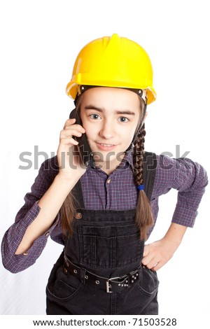 LIttle master girl with drill - stock photo