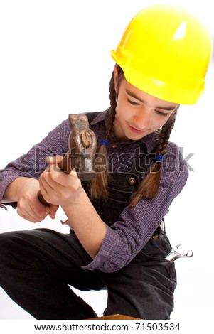 LIttle master girl with hammer - stock photo