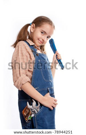 LIttle master girl with wrench - stock photo