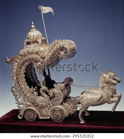 little masterpiece of art in golden or silver filigree, horse-drawn carriage - stock photo