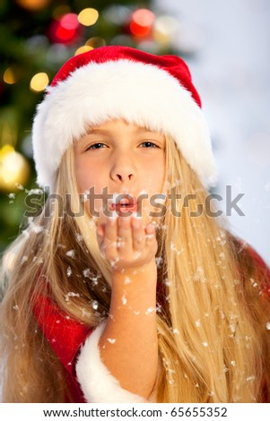 little miss santa playing with snow - stock photo