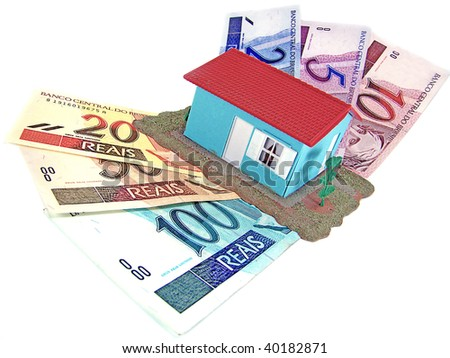 little model house over a lot of brazilian real banknote - stock photo