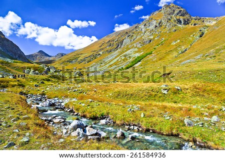 Little mountain river. Picture was taken during trekking hike in  gorgeous scenic mountains of north Caucasus at autumn, Arhiz region, Abishira-Ahuba range, Karachay-Cherkessia, Russia   - stock photo