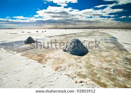 Little mountains of salt in Salar de Uyuni in Bolivia - stock photo