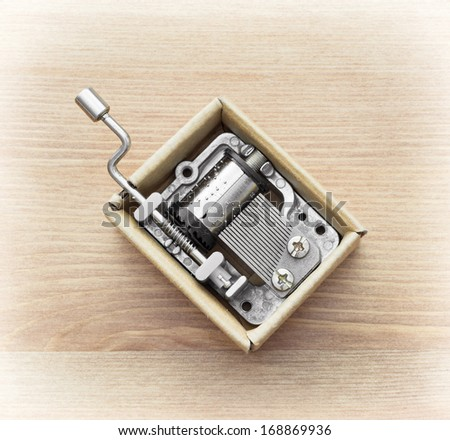 Little music box on a wooden background. - stock photo