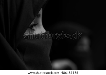 Little muslim girl with covered face
