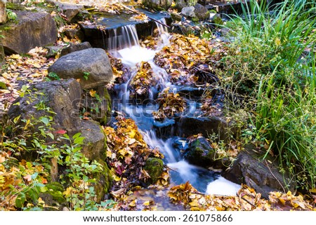 Little Natural Waterfalls in Autumn in a park of Montreal - stock photo