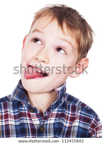 Little naughty boy portrait sticking out his tongue - stock photo