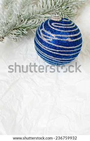 Little New year tree toy and a New year tree brunch on the backing - stock photo