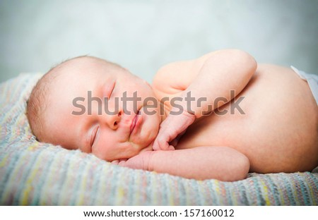 Little newborn baby boy  sleeps