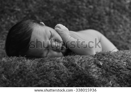 Little newborn baby, sleeps or Newborn baby peacefully sleeping in black and white photography - stock photo