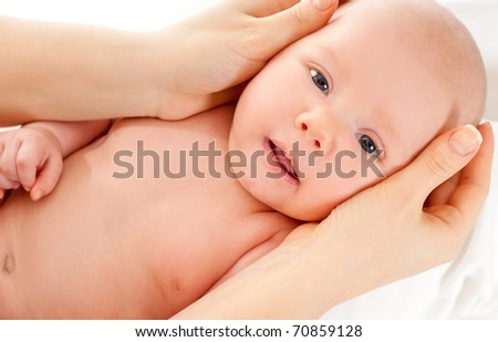 little newborn boy in mother's hands - stock photo