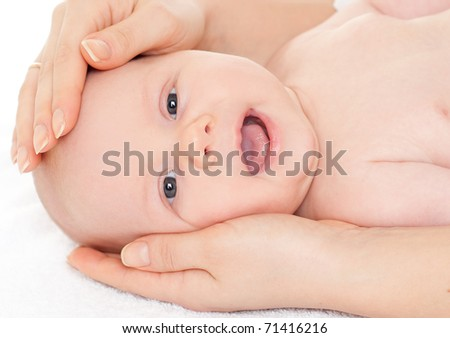 little newborn boy in mother's hands
