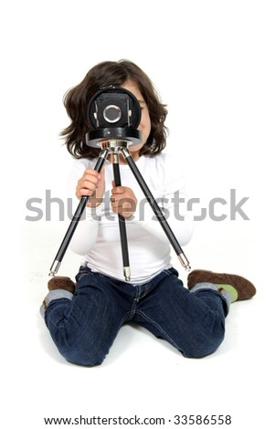 Little nice model making a shot with camera on tripod - stock photo