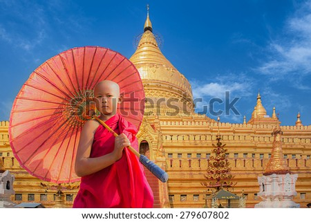 Little novive and golden pagoda in Bagan, Mynmar - stock photo