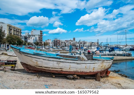 Little old boats in the harbor of Mola di Bari, south of Italy - stock photo