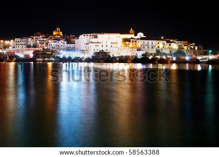 Little old city of Termoli on the mediterranean sea with bright reflection in the sea - stock photo