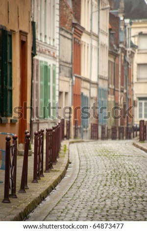 Little old cobblestone street in Lille, France - stock photo