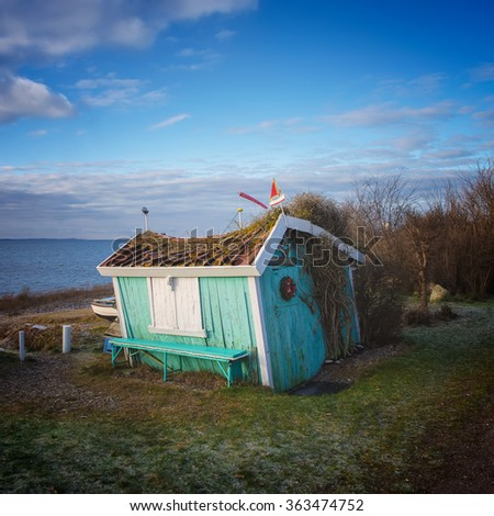little old hut by the sea - stock photo