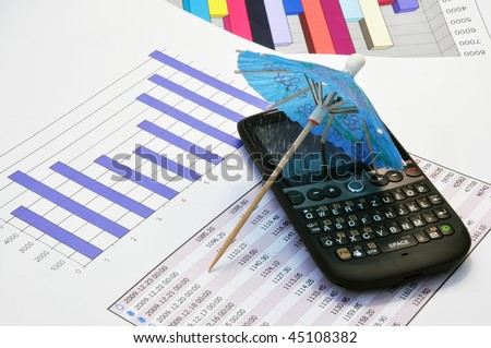 Little paper umbrella and a cell phone on a market report