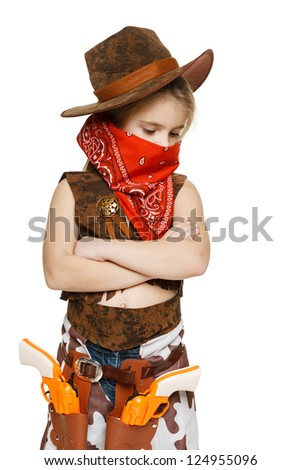 Little pensive girl wearing cowboy costume standing with folded hands looking down, over white background - stock photo