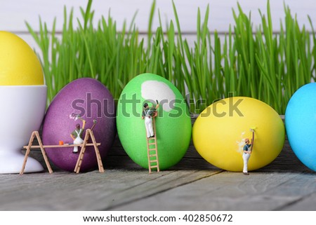 Little people paint eggs. The concept of holidays. the concept of teamwork. - stock photo