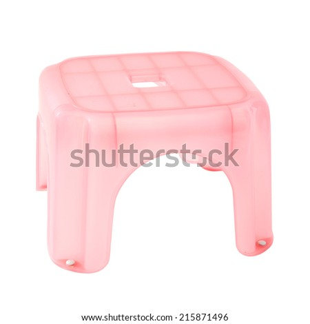 Little pink plastic stool isolated over white - stock photo