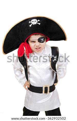 Little pirate boy is posing to the camera while his hands on waist. Isolated on white.