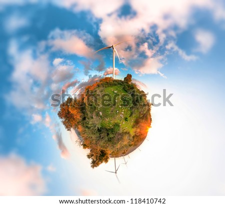 Little Planet with wind turbines generating electricity on sunset - stock photo