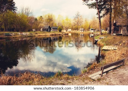 Little pond on a cloudy day - stock photo
