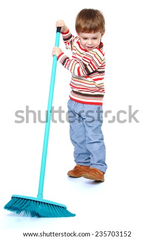 Little positive boy sweeping the floor.White background, isolated photo. - stock photo