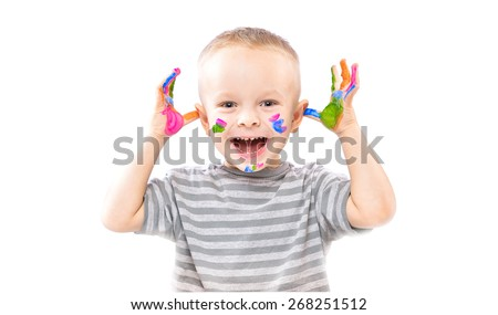 Little positive boy with painted hands in bright colors.