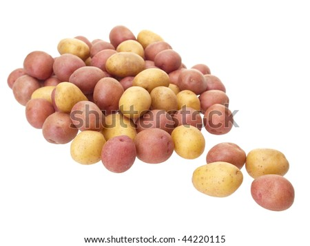 Little potatoes on pure white background - stock photo