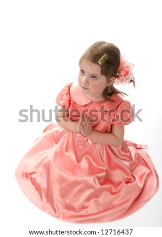 Little praying girl on a white background. - stock photo