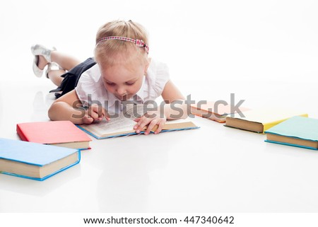Little preschool girl read book, isolated on white background - stock photo