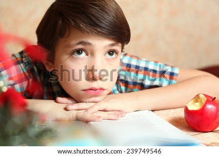 little preteen boy do his homework - stock photo