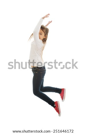 Little pretty girl jumping with joy - stock photo
