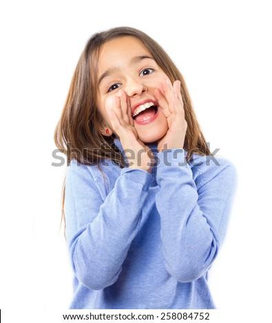 Little pretty girl shouting against white background - stock photo