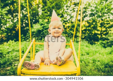 Little pretty girl walking outdoor in the park - stock photo
