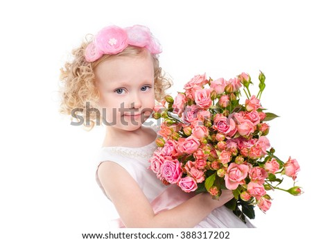 Little pretty girl with bouquet of roses