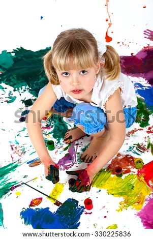 Little pretty girl with paints over white background