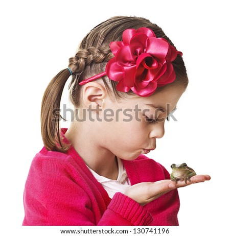 Little Princess kissing a frog - stock photo