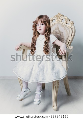 little princess sits on the throne - stock photo