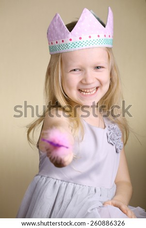 little princess with the magic wand  - stock photo