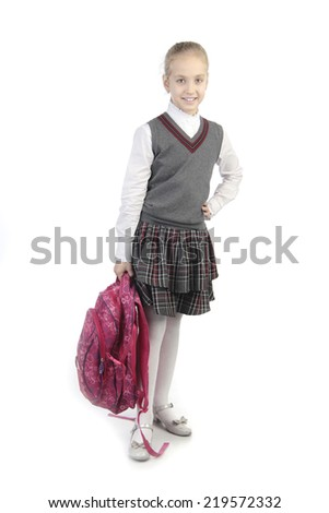 little pupil standing on isolated white background - stock photo