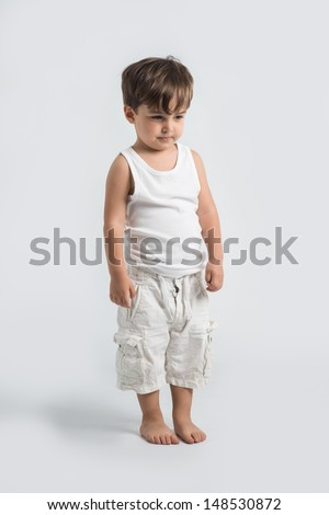 Little quilty boy having punisment full lenght body shoot - stock photo