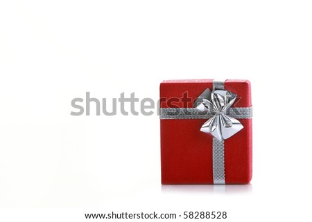 Little red gift box isolated on white with lots of copy space - stock photo